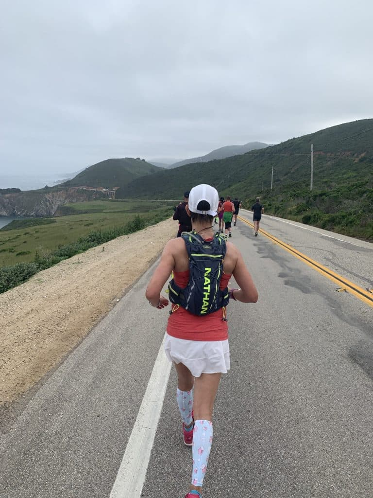 big sur marathon race recap with female runner on course