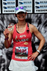 female runner at Big Sur Marathon finish line
