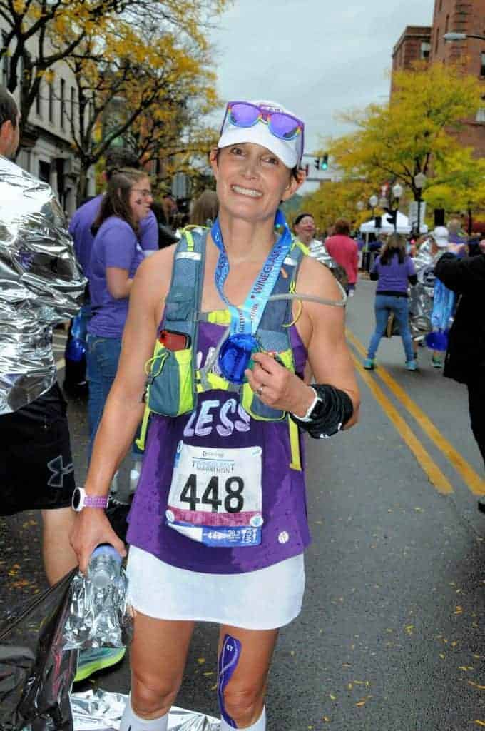 Female runner at finish line of Wineglass Marathon Race