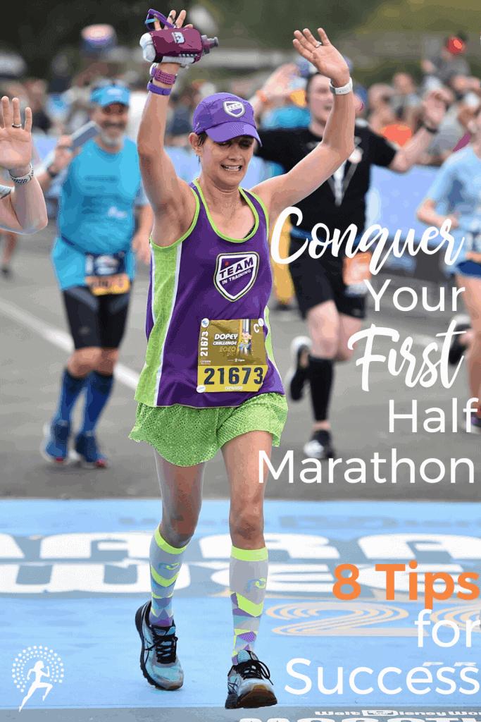 woman runner finishing disney half marathon