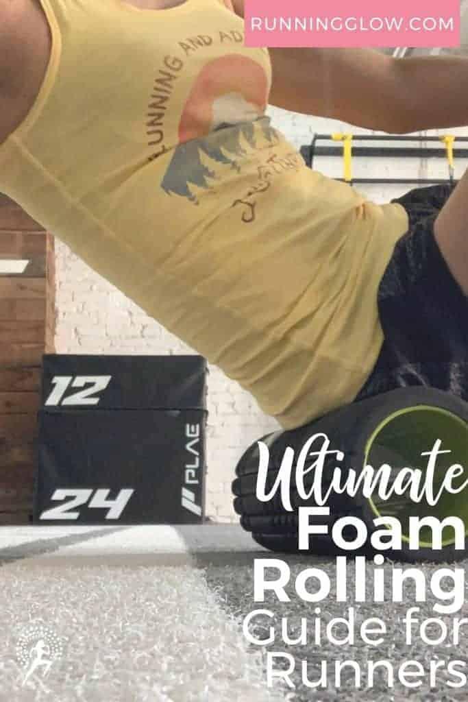 female runner rolling glute area on foam roller
