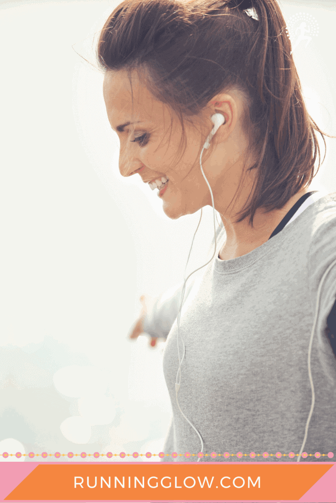 female runner with headphones doing run walk method